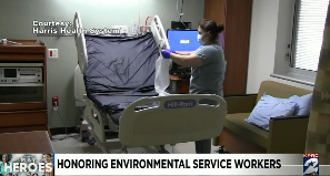 EVS worker cleaning hospital bed at Harris Health